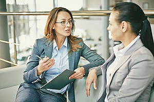an interim HR support consultant speaking with a business employee while the company does not have an in-house HR consultant