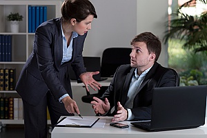 a boss arguing with her employee after he filed an HR complaint with an HR consulting firm