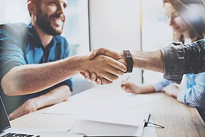 a handshake between a business owner and an HR consulting expert