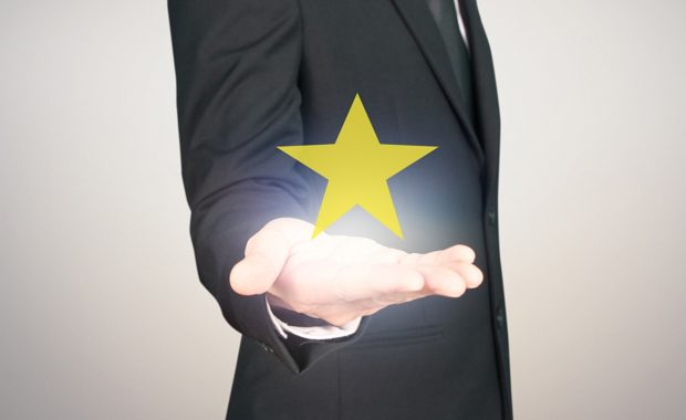 a talent acquisition manager holding a gold star which represents new talent for a company