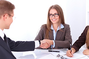 a talent acquisition specialist meeting with a business owner