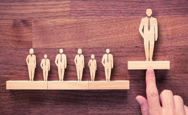 wooden cutouts of employees representing talent management services