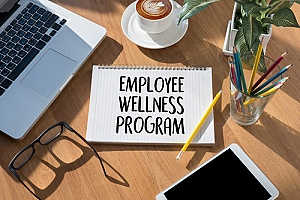 the words employee wellness program written on a piece of paper