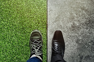 a man wearing a shoe on one foot and a boot on the other to represent the work life balance