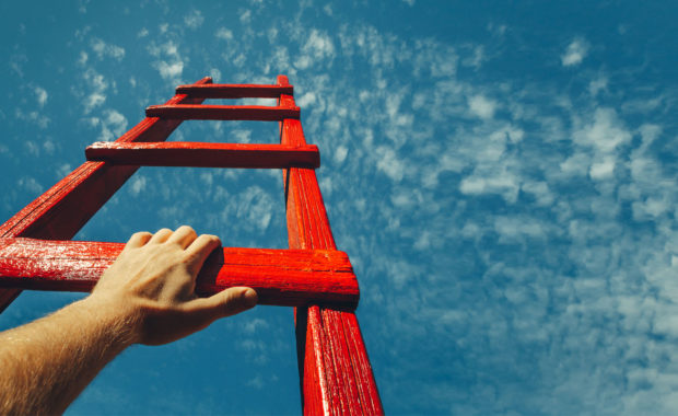 an employee climbing a ladder representing the path to success