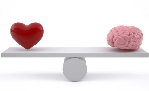 heart and brain on scale showing the importance of emotional intelligence