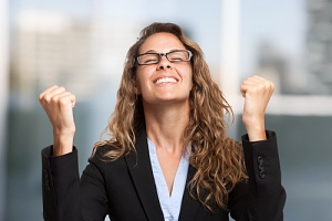 a woman employee happy about her flexible work arrangements