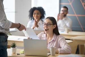 woman employee happy because of important employee recognition