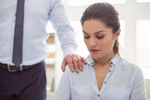 woman not liking how to handle harassment in the workplace