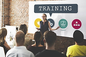 an employee training meeting run by an outsourced HR solutions firm
