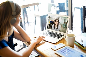 Woman telecommuting in for a meeting