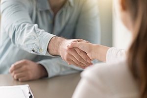 HR consultant shaking client's hand