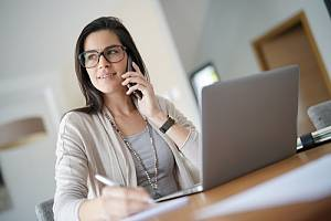 Woman on phone working remotely