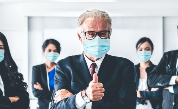 Employees in masks in office