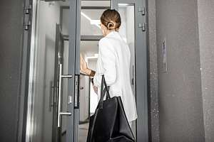 Woman entering stairwell of office