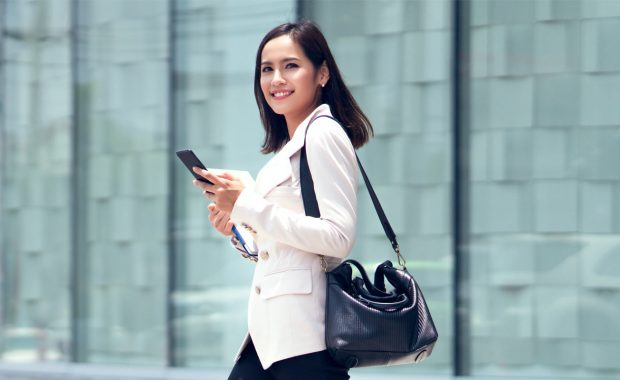 Woman on phone returning to office