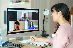 Employees in online training session