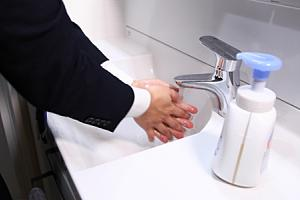 Employee washing hands