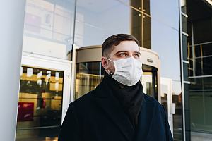 Employee outside building in mask