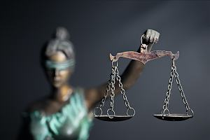 Lady justice holding level