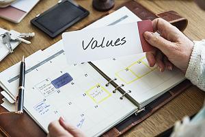 Employee writing down values in agenda
