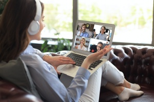 women talking with friends over computer