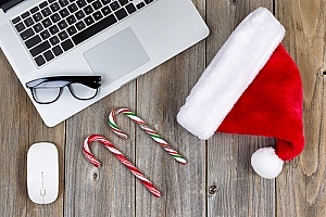 holiday items in front of work laptop