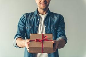 man gifting box with ribbon
