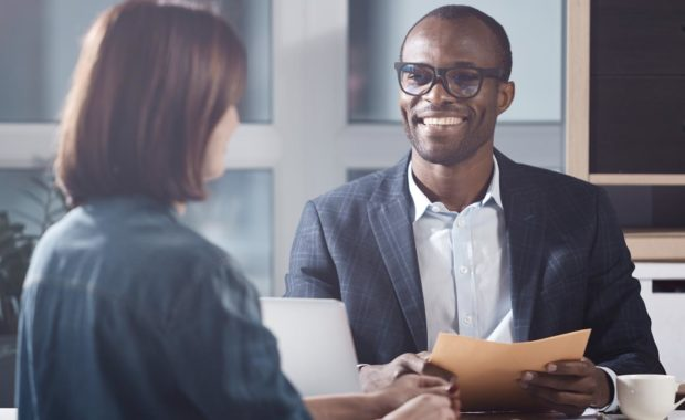 Successful manager talking to employee