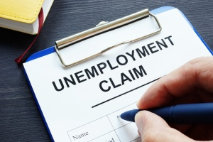 Unemployment claim on clipboard being filled out since unemployment benefits be extended into 2021