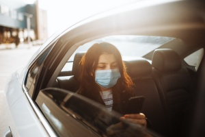 women wearing her mask while in the car with another virginia employer