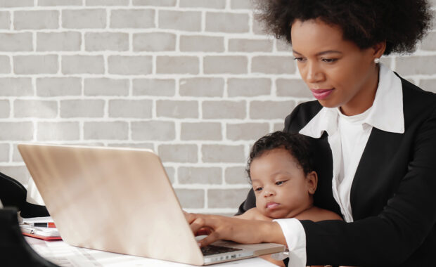 women working from home while her employer is helping