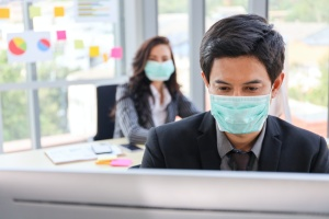 two business workers wearing masks