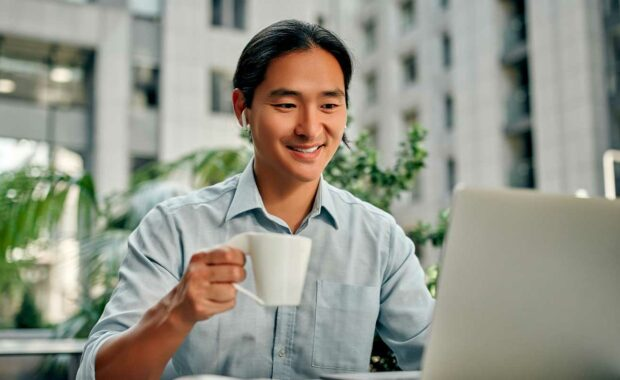 man who is a remote employee with cup of coffee