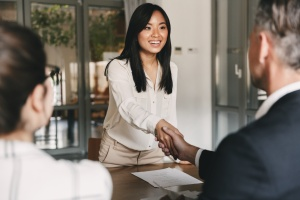 Woman finishing interview for talent acquisition assessment