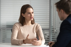 Female employee going over Employee Leave Management