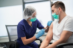man getting his shot after his Workplace Vaccination Mandates