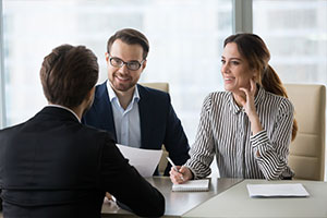 Interviewers interviewing employee for organizational assessment