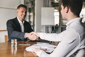 organizational worker shaking hands after organizational assessment