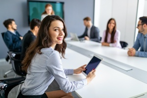 women talking in office about retention strategy
