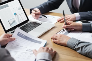 ACA Reporting Services finding a business in a meeting