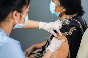 women getting a shot because of a Mandatory Vaccination Policy